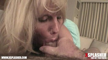 MILF with big tits sucking on a big dick