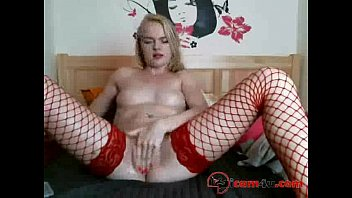 Beautiful girl in red stockings brings her pussy to a boil and disturbs ass with fingers