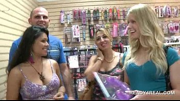 Hot blonde shows off tits for money in a store