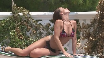Sensational brunette reveals her big beautiful tits