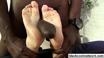 Sexy young blonde interracial footjob