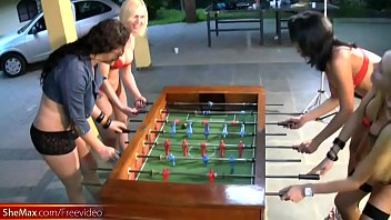 T-girls strip down lingerie and stockings playing foosball