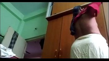 desi mature telugu aunty vani dressed in half-top.