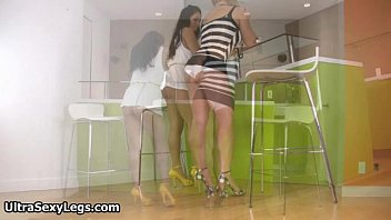 Two sexy babes in high heels showing