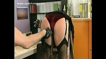 Milf secretary slave is spanked in de office on her ass and bit in her nipples by her masked boss