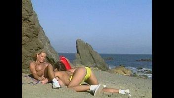 Sondra Hall and Jordan Haze lesbian sex on the beach.