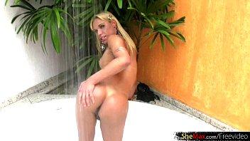 slender latina she-masculine in ebony bathing suit milks.