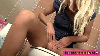 Beautiful teenage blonde rubs her cunt