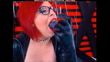 mature red-haired with glasses throating pummel.