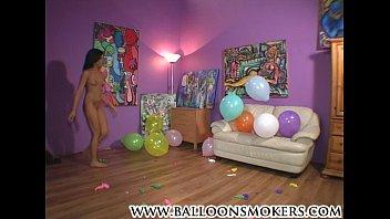 teenager pops balloons nude