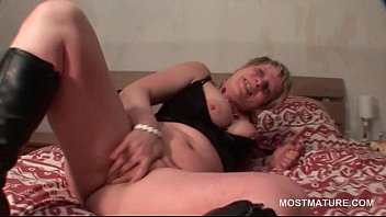 Chesty mature in lace rubs shaved horny twat