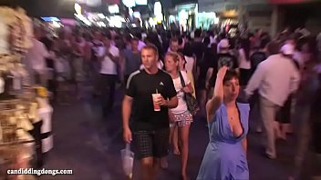 Busty Russian Milf walking down the street, candid bouncing boobs, cleavage