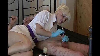 domme nurse uses  sounds on her strapped gimp
