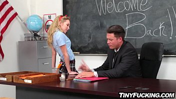 Petite blonde schoolgirl seduces her teacher fucks him on desk