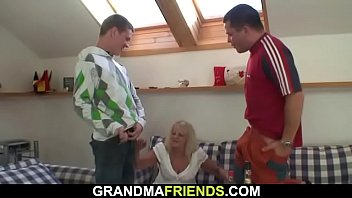 blond older dame takes two yam-sized pricks at once