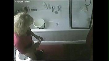 Hidden cam caught my slut mom masturbating in toilet
