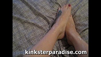 FOOT FETISH - rubbing lotion on sexy feet close up - kinksterparadise.com